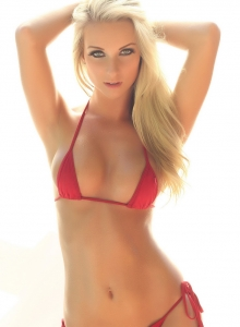 Blonde Alluring Vixen tease Aneta shows off her perfect curves in a skimpy red string bikini outdoors
