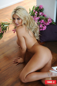 Tommie Jo strips naked by the fire place from her floral swimsuit and spreads her legs for you