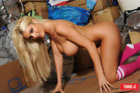 Tommie Jo strips out of her sporty pink top, panties and high top socks