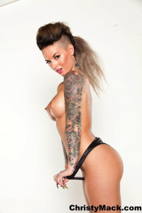Christy Mack flaunts her amazing body in her black leather corset