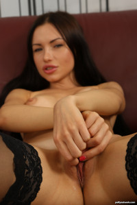 Hot brunette toys both of her holes