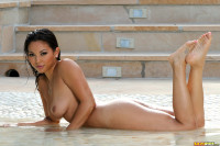 Adrianna Luna chocolate nipples poking through fishnet bikini