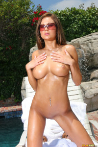 Amy Reid phenomenal sun drenched body in sheer pink thong bikini