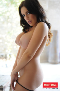 Ashley Emma strips from her white and black lingerie
