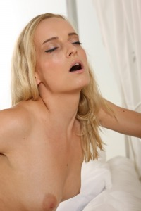 Horny blonde gets off with a magic wand vibrator