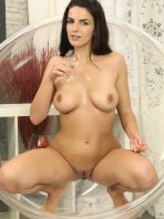 Sexy brunette Cynthia pisses into a chair