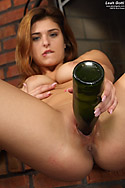 Leah Gotti Spreads with Candles and Rams Wine Bottle