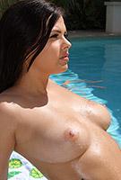 Keisha Grey wet and naked in sheer orange gstring micro bikini